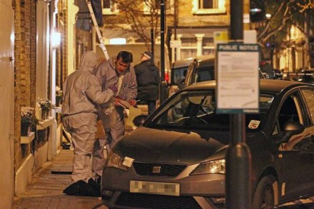 Forensics go over the car on Marston Road. Image: Nigel Howard